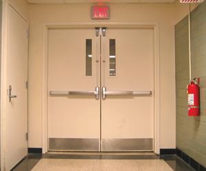A picture a door needing it's annual fire door inspection.